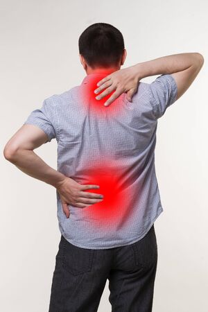 Pain in the male body, man with backache, sciatica and scoliosis, chiropractor treatment concept, painful area highlighted in red