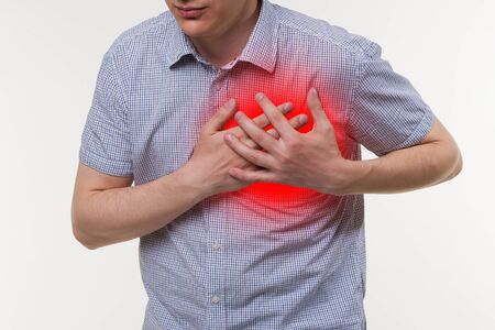 Heart attack, man with chest pain, painful area highlighted in red