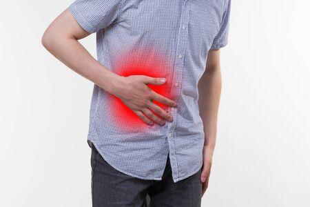 Blinddarmentzündung, Mann mit Bauchschmerzen, schmerzhafter Bereich rot hervorgehoben Standard-Bild