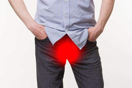 Pain in prostate, man suffering from prostatitis or from a venereal disease on white background