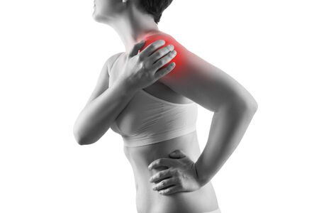 Shoulder pain, ache in a womans body, sports injury concept, isolated on white background, painful area highlighted in red Фото со стока