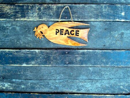dove of peace: Peace Dove Ornament on Old Antique Trunk