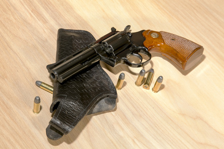 38: A classic .38 special revolver with spare ammunition and holster