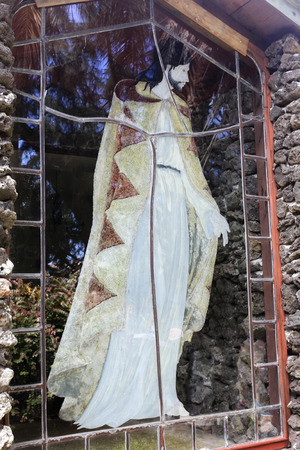 cried: The painted image of Jesus on a tall window of the now abandoned Palapala Ho Omau Congregational Church on Maui, Hawaii.  Built in 1864, this is the burial place of Charles Lindberg Stock Photo