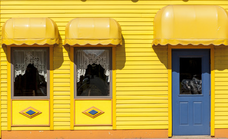 awnings: The colorful facade of a small town restaurant Stock Photo