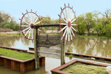 manually: A vintage manually  operated sluice gate on a river