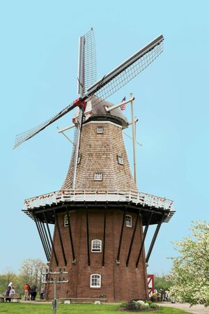 dutch: A Dutch windmill in Western Michigan with tourists and character actors depicting the culture of the setting.