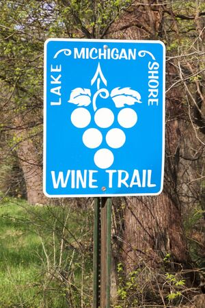 wine road: Roadside sign promoting wine and tourism in Michigan Stock Photo