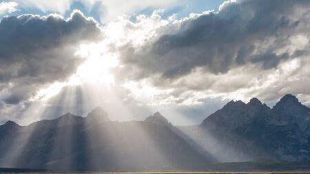 sunshines: Rays of sunlight break through the clouds onto the Grand Teton Mountain Range in Grand Teton National Park
