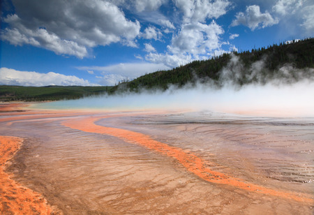 emanating: Colorful bacterial patterns emanating from Grand Prismatic Spring in Yellowstone National Park Stock Photo