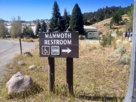 humor: Signage depicting a public restroom in Mammoth Hot Springs, Yellowstone National Park