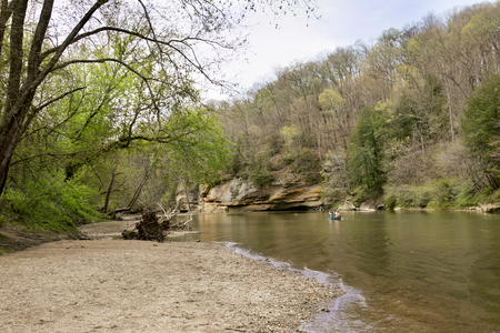 Visitors paddling a canoe on Sugar Creek in Turkey Run State Park, Indiana in early spring Stock Photo