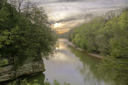 The sun sets in the spring on Sunset Point over Sugar Creek in Turkey Run State Park, Indiana Stock Photo