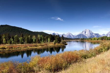 The beautiful Snake River meanders through Grand Teton National Park at Oxbow Bend, with the Teton mountains in the background.  In Jackson, Wyoming