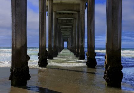 Looking out into the Pacific Ocean from beneath the famous Scripps Pier in La Jolla, San Diego, California
