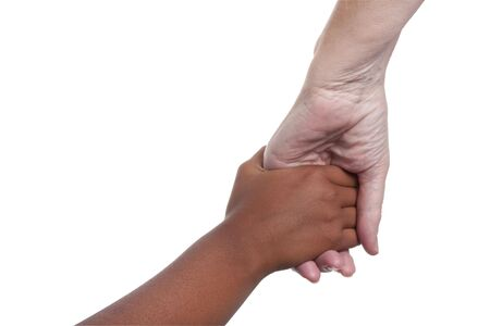 young dark skinned mixed race girls hand holding older fair skinned senior womans hand. isolated against white background includes clipping path. photo