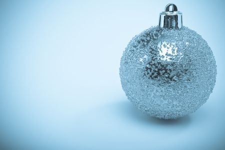 Cold toned monochromatic image of a christmas decoration with vignette photo