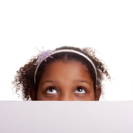 Adorable mixed race little girl peeping over edge of sign isolated on white background photo