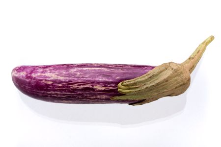 Thin Purple Aubergine with stalk isolated against white background. Stock Photo - 5557762