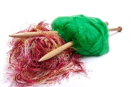 mohair: Large ball of red and green mohair wool or yarn pierced with large wooden knitting needles against white background. Stock Photo