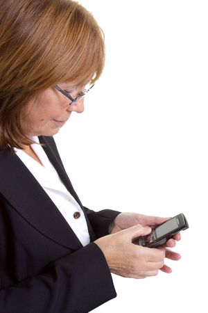 Older senior woman using a cell phone in business situation photo