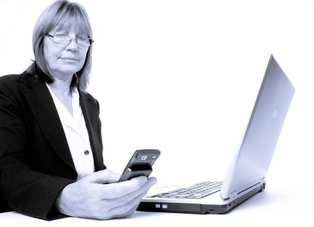 arthritic: Monochromatic image of Older senior woman with arthritic hands in business situation