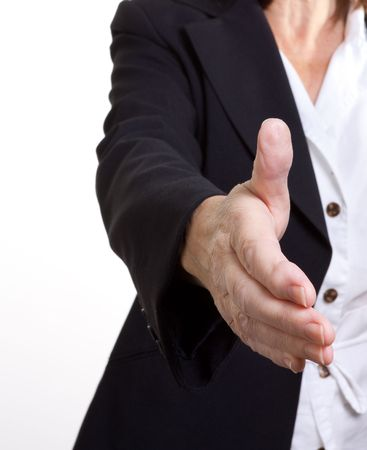 arthritic: Older senior business womans arthritic hand with knobbly fingers in a welcoming hand gesture. Stock Photo
