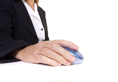 Older senior business womans arthritic hand with knobbly finger operating mouse photo
