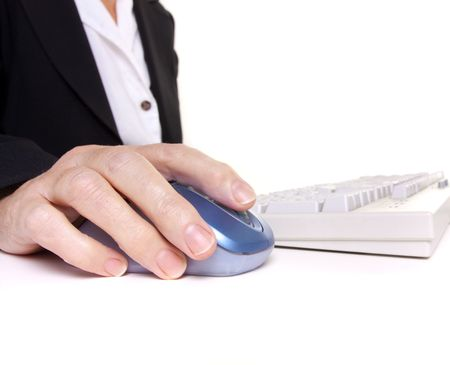 arthritic: Older senior business womans arthritic hand with knobbly finger operating mouse