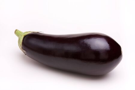 Large dark shiny purple Aubergine isolated against white background. Stock Photo - 5950559