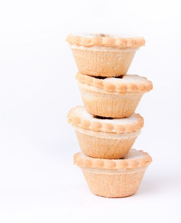 Tower of sugared Sweet Mince Pies against plain white background. photo