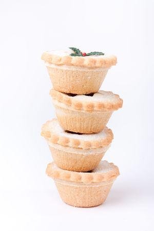 minced pie: Tower of sugared Sweet Mince Pies against plain white background. Stock Photo
