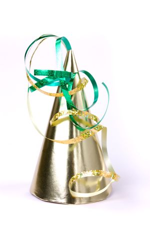 conical hat: Gold cone shaped party hat isolated against white background.