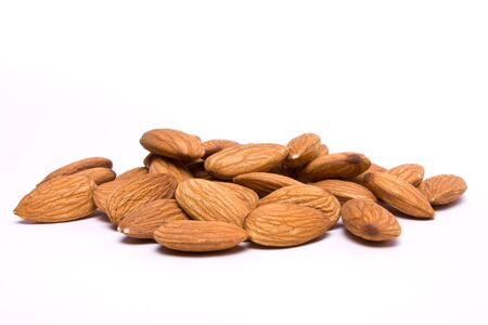 shelled: A pile of shelled almond nuts isolated against white background.