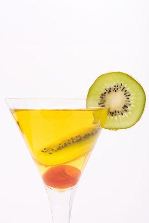 Mixed Fruit cocktail of kiwi, cherry and lemon juice isolated against white background. photo