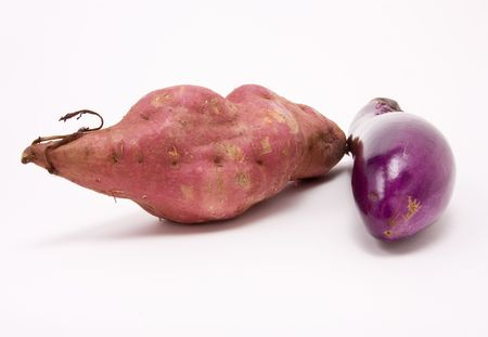 Sweet potato and Aubergine against white background from low perspective. Stock Photo - 6168221