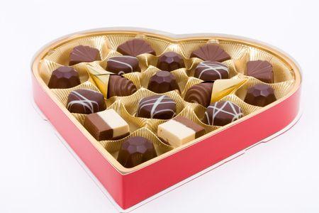 Heart shaped box of Valentine Chocolates against white background.