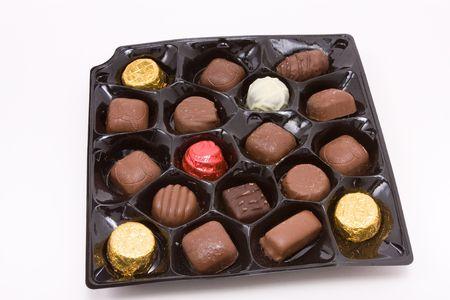 Close up of a box of luxury milk and dark Chocolates. photo