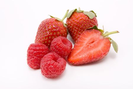 Natural vibrant red Strawberries and Raspberries isolated against white background. photo