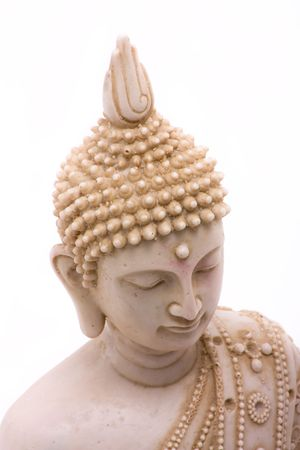 Buddha statue close up isolated against white background. photo
