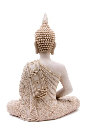 buddha face: Buddha statue from rear against white background. Stock Photo