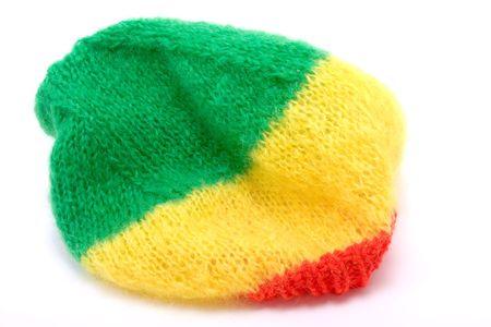 Knitted woollen bonnet  hat in the rasterfairian colours. photo