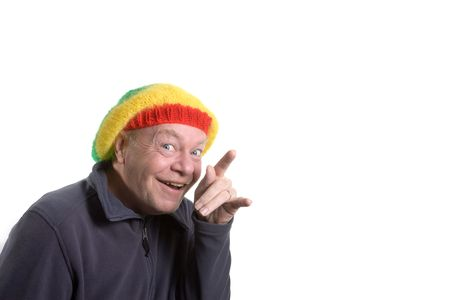 clowning: Silly old Man wearing rasta bonnet clowning around.