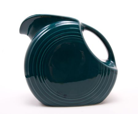 housewares: Old green retro vintage jug isolated against white background.