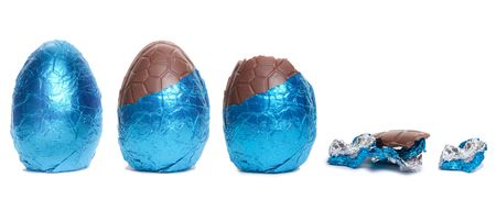 The lifecycle in stages of a Blue Foil covered chocolate easter egg isolated against white background. photo