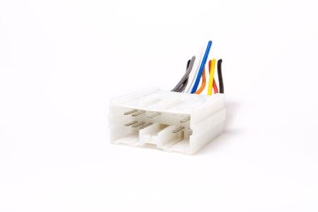 car audio: Multi pin car audio DIN connector isolated against white background.