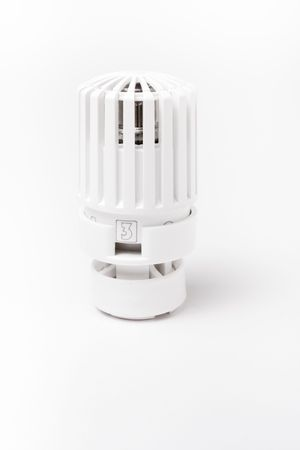 Thermostatic domestic central heating valve top isolated against white background. photo