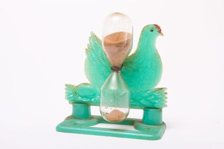 the novelty: Grungy Vintage novelty egg timer in the shape of a chicken isolated against white background.