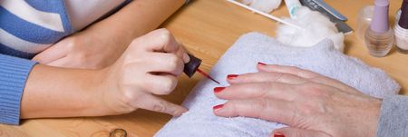 Older senior woman with arthritic hands receiving home spa treatment / manicure. Stock Photo - 6452318