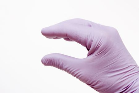 Male hand wearing purple latex surgical glove hand gesture isolated against white background. photo